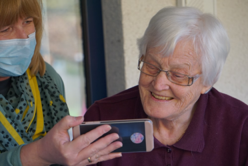 Old person uses a phone